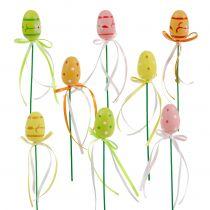 Œufs sur piques avec nœuds divers coloris 4 cm 16 p.