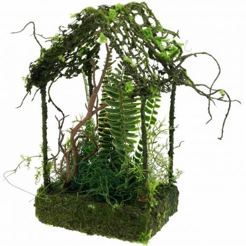 Maison d'herbe de décoration de mousse avec mousse artificielle et fougère