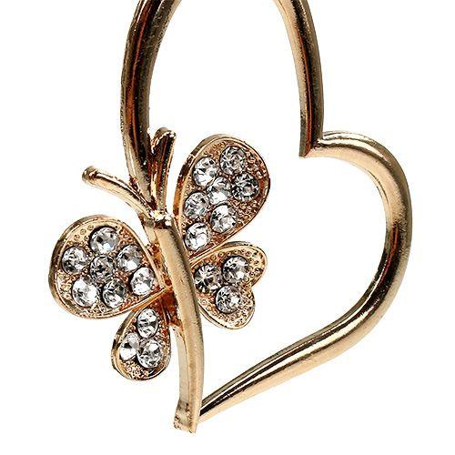 Coeurs à suspendre avec papillon 7 cm or et argent 2 p.